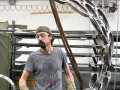 """Andrew Scanlon works on """"Holons,"""" a steel sculpture on display as part of Commence: Sculpture projects 2015"""