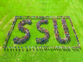 "SSU students and their families spell out ""SSU"" at Welcome Weekend."