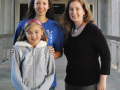 Professor Sheila Katz and SSU student Kristel England, a welfare mother who attends SSU, and her daughter.