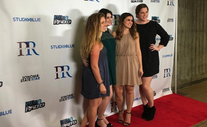students posing for pictures at the red carpet