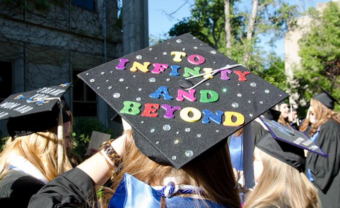 "grad cap reading ""to infinity and beyond"""