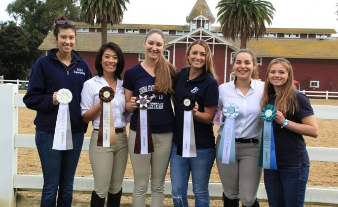 Equestrian team members proudly display their awards.