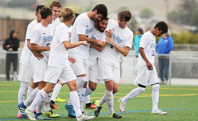 men's soccer team celebrates victory