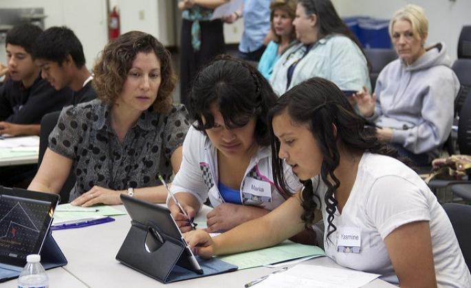SSU Education Professor Kelly Estrada, left, in the classroom with K-12 students