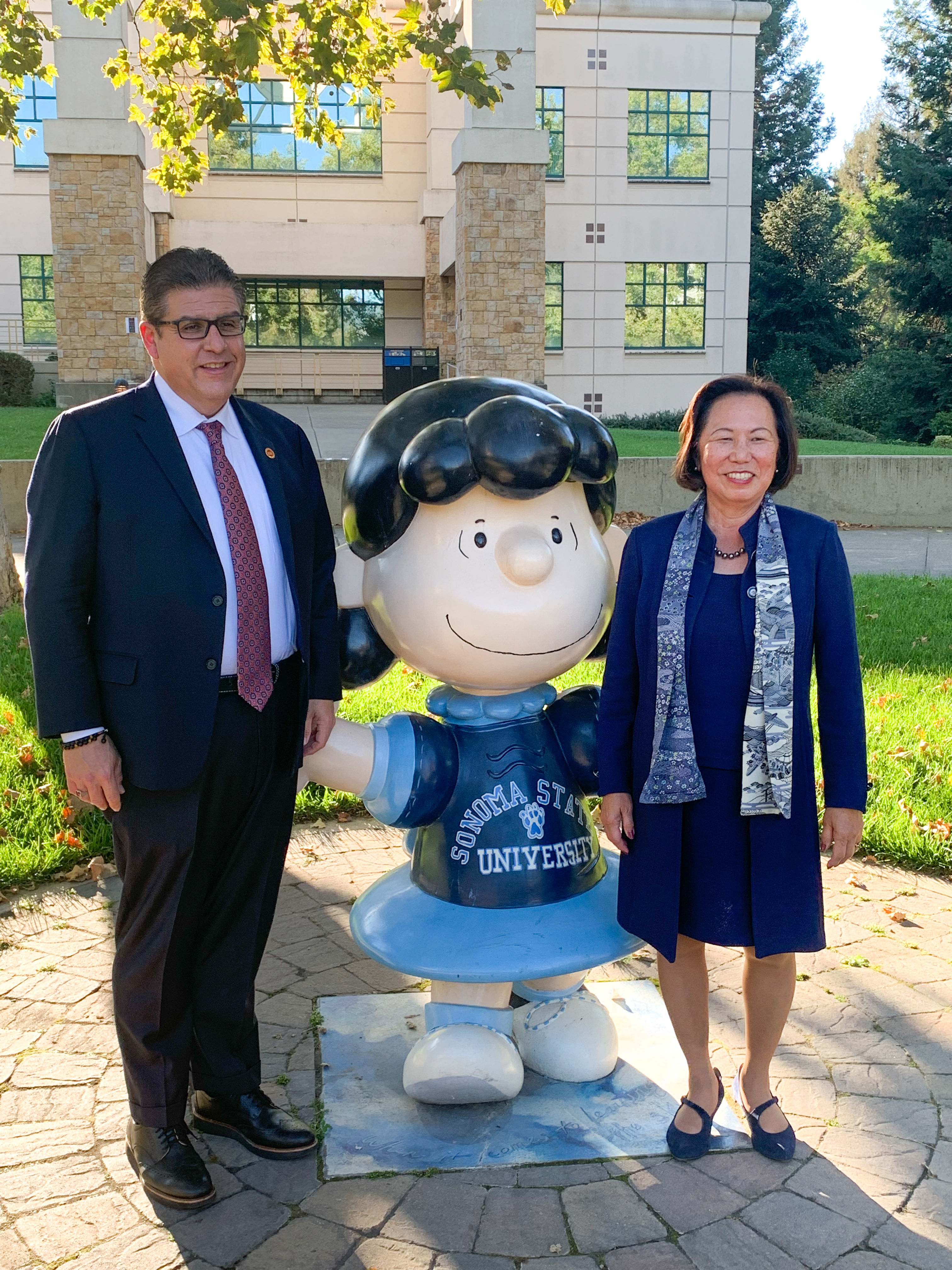 Chancellor Castro poses for photo with President Sakaki at the Lucy statue