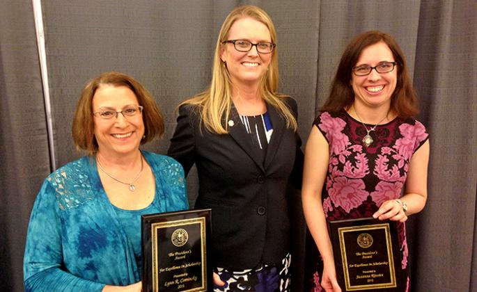 School of Science and Technology dean Lynn Stauffer congratulates Lynn Cominsky and Suzanne Rivoire on receiving the Sonoma State Excellence in Scholarship Award.