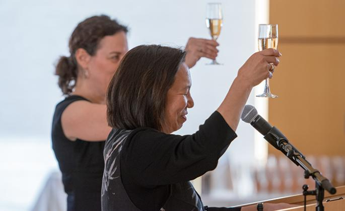 Sonoma State University President Judy K. Sakaki and OLLI Director Carin Jacobs toast the OLLI program at a champagne reception Friday afternoon after President Sakaki announced it has received a $2 million bequest.