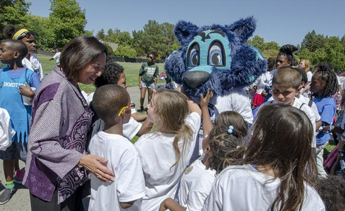 President Judy Sakaki meets with Lobo the Seawolf and students from RFDC