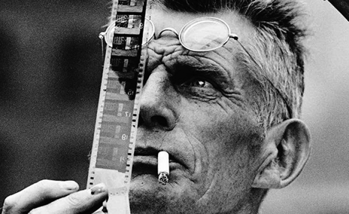 Samuel Beckett examines a piece of film