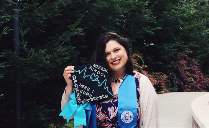 Emma Towslee showing off her graduation cap