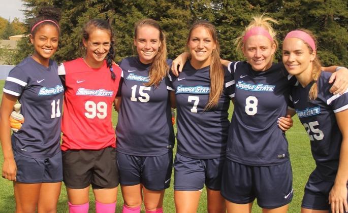 women's soccer team posing for photo