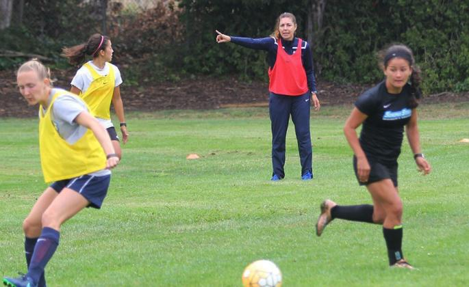 Seventh-year head coach Emiria Salzmann Dunn instructs players during Tuesday's training session.